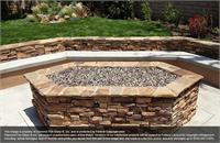 Tuscan Reserve Fireplace Glass installed in an outdoor fire pit